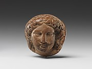 Head of Dionysus (?) for attachment, possibly for a couch