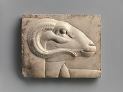 Relief plaque with ram's head from a god's figure