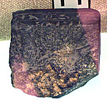Fragments of a statue of Neferpsamtik which mentions Apries: base