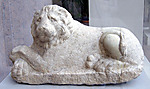 Reclining lion on a grave monument (?)