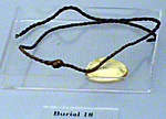 Necklace with a disk amulet