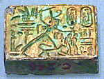 Oblong Plaque Depicting Ramesses II Smiting Enemies, opposite side relief scene of Isis and Nephthys flanking falcon labeled Horus son of Isis
