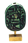 Scarab Depicting Seti II In His Chariot Shooting a Bow and Arrow.