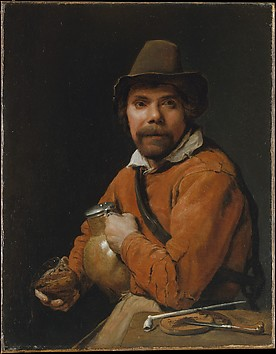 Man Holding a Jug