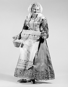 Old woman carrying a wire basket