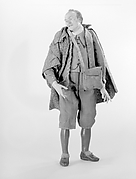 Man with cape and leather pouch
