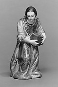 Kneeling woman with a basket (from a nativity)