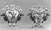 Pair of nozzled vases