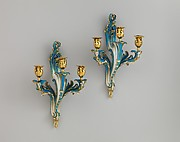 Pair of three-light wall sconces