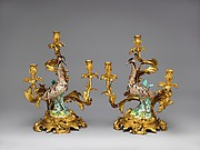 Pair of candelabra with Meissen bird