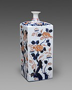 Bottle with flowers of the four seasons