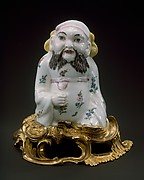 Figure of a seated Chinese man
