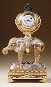 Miniature clock in the form of an elephant supporting a watch case