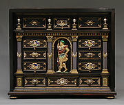 Cabinet with gold mounts and relief