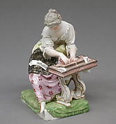 Lady seated at spinet