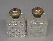 Set of five bottles with covers