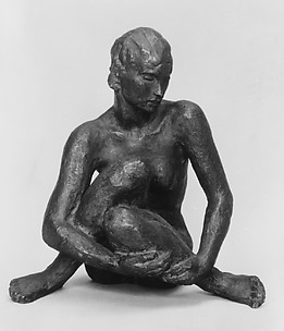 Seated statuette