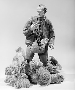 Shepherd with lamb in shoulder bag
