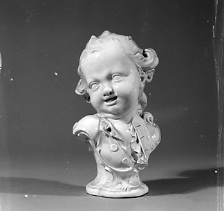 Bust of a laughing boy