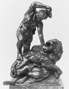 Two Men Fighting a Lion