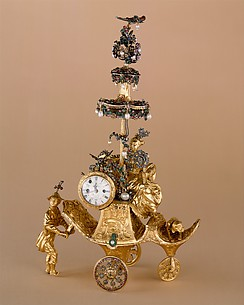 Automaton in the form of a chariot pushed by a Chinese attendant and set with a clock