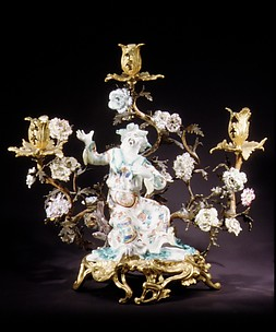 Figure mounted as a candelabrum