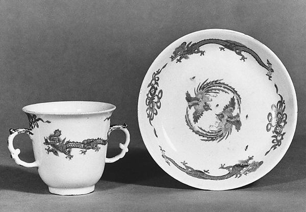 Chocolate cup and saucer with dragons and phoenixes
