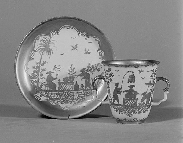 Two-handled beaker and saucer