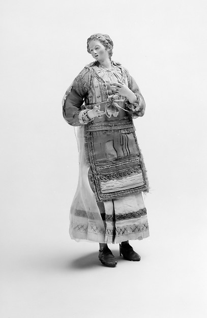 Standing woman in festival dress