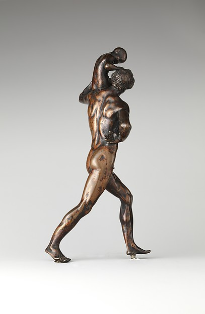 Man Carrying a Child on His Shoulder