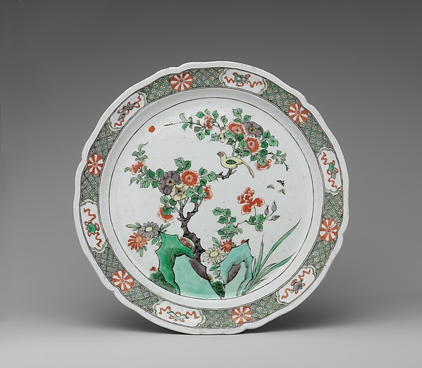 Dish with rocks, flowers, and birds
