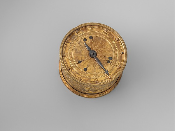 Table clock with skeleton movement