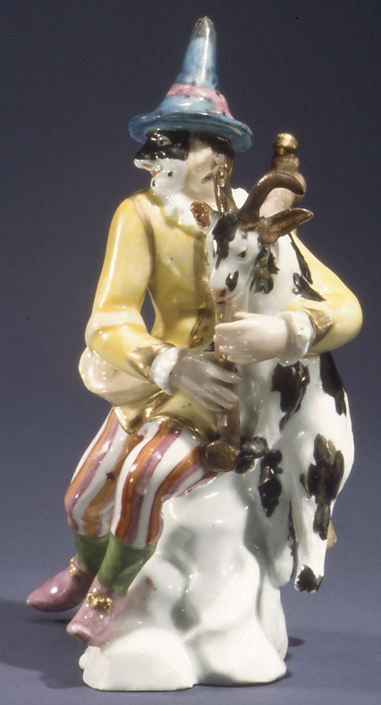 Harlequin with goat as bagpipes