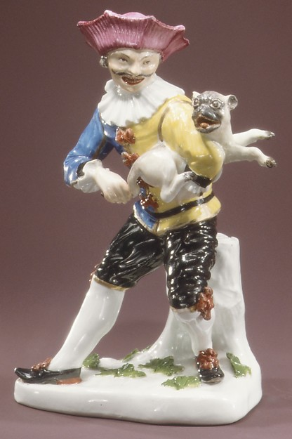 Harlequin with pug as hurdy-gurdy