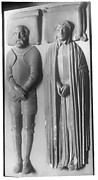 A man in armor and his wife in a long cloak (possibly Huguenots)