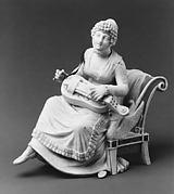 Woman playing a hurdy-gurdy
