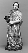 Standing woman with a bowl on a plate from a nativity