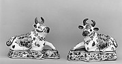 Pair of reclining cows