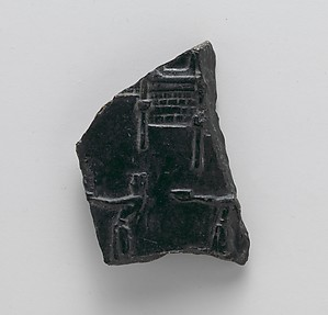 Reproduction of a stone vase fragment with offering bearers at a shrine