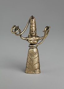 Reproduction of a fake gold snake goddess statuette
