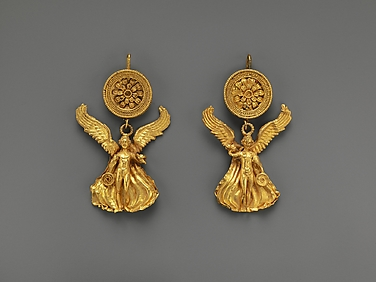 Pair of gold earrings with a disk and Eros