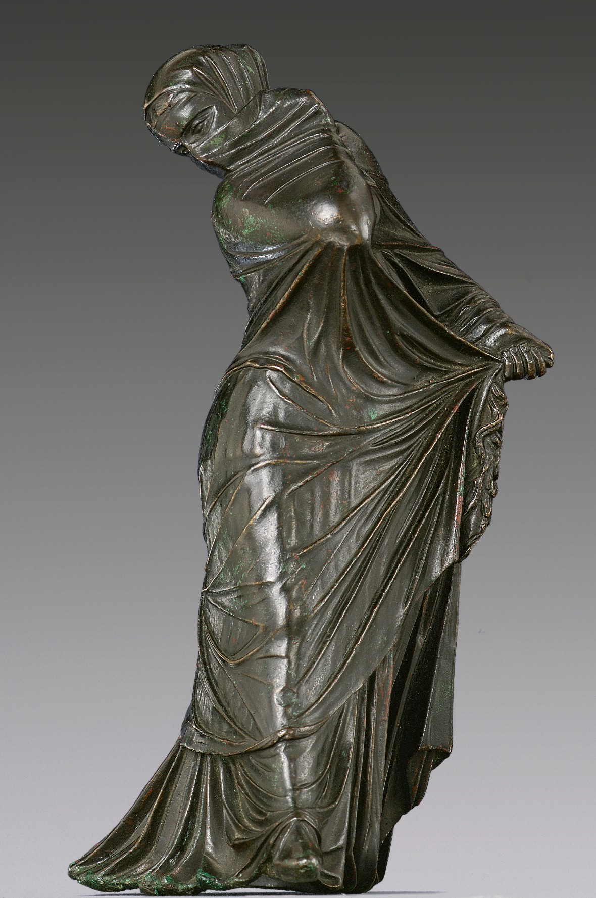 Bronze statuette of a veiled and masked dancer | Work of