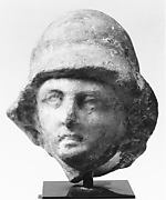 Small helmeted head from a marble relief