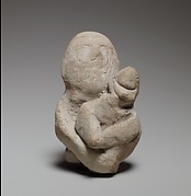 Two figures in a scene of childbirth