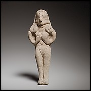 Terracotta statuette of a nude woman