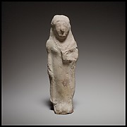 Standing female figurine holding a flower