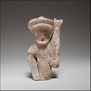 Terracotta statuette fragment of a male votary holding a kid
