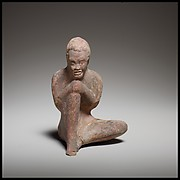 Terracotta statuette of a seated African (known as Ethiopian) boy