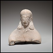Head and upper body of a female figurine