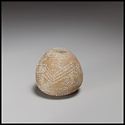 Terracotta conical-hemispherical spindle-whorl with rounded base